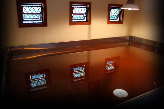 The Allagash coolship.  Notice the open stained glass windows to let the wild yeast and bacteria drift in.  (Image taken from Allagash's website)