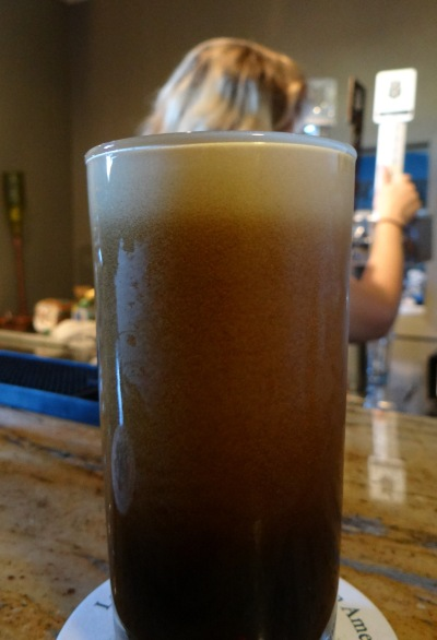 The nitro cascade on display in glass of Fat Julian.