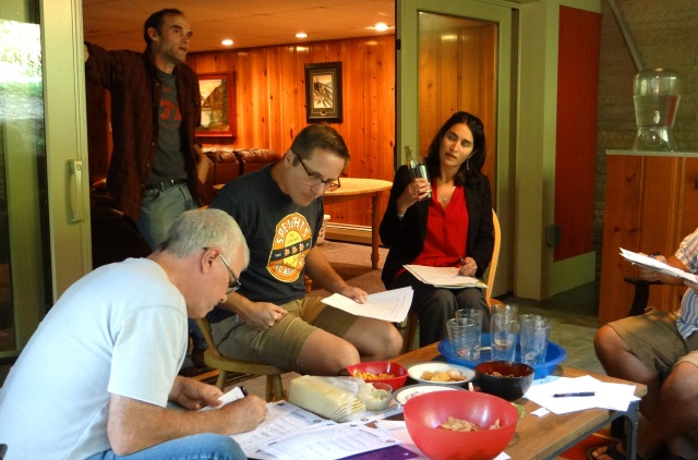 George takes careful notes while Hannah and Ted debate the merits of southern hemisphere hops.