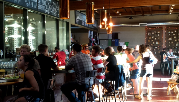 The taproom at Crux as the sun sets in the west.