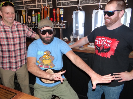 Jared, Trevor and Ryan (left to right) celebrate taking home the King of Ohio championship belt at the Ohio Taproom.