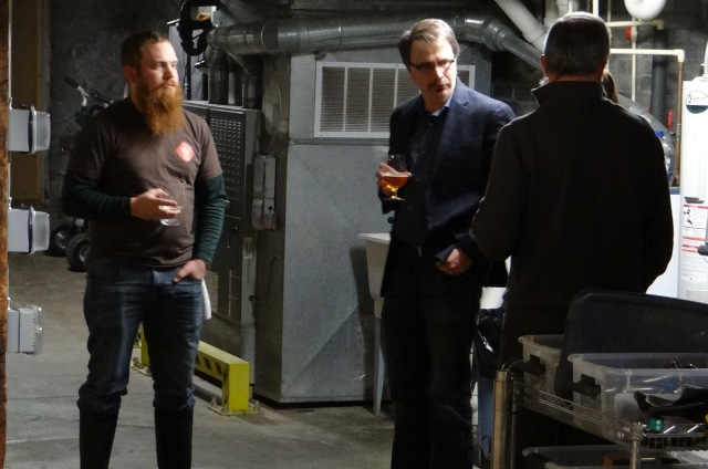 The basement at Wolf's Ridge with (left to right): head brewer Chris Davison, me, and co-owner Alan Szuter.  Melissa is standing between Alan and I but cannot be seen.