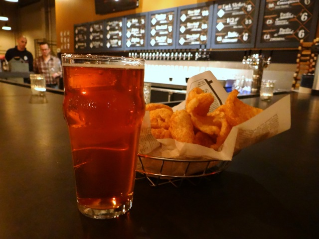 A pint of Driftwood Citrus Surf and an order of pork rinds.