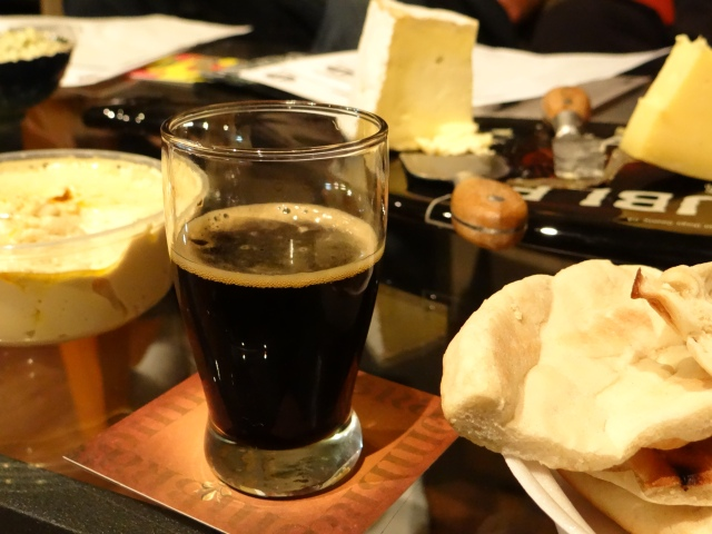 As if there weren't enough calories in a 12% abv stout, why not throw in some rich buttery cheese and pita bread.
