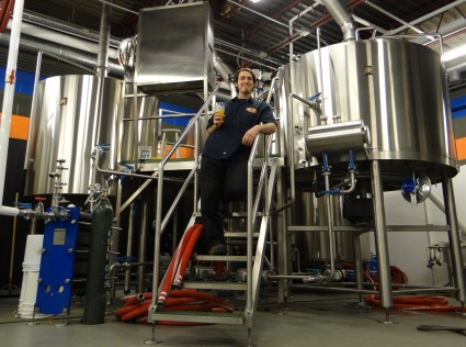 Head brewer Cameron Lloyd and the shiny new brewkit at Zauber.