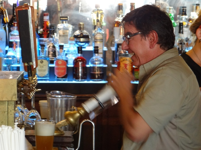 Angelo pours a pint of Centennial IPA from one of the beer engines at Barley's.
