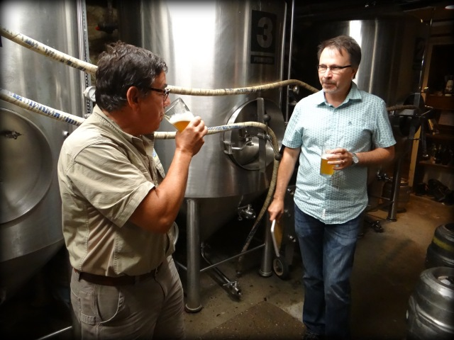 Angelo shows us around the brewing equipment in the basement of the Alehouse.
