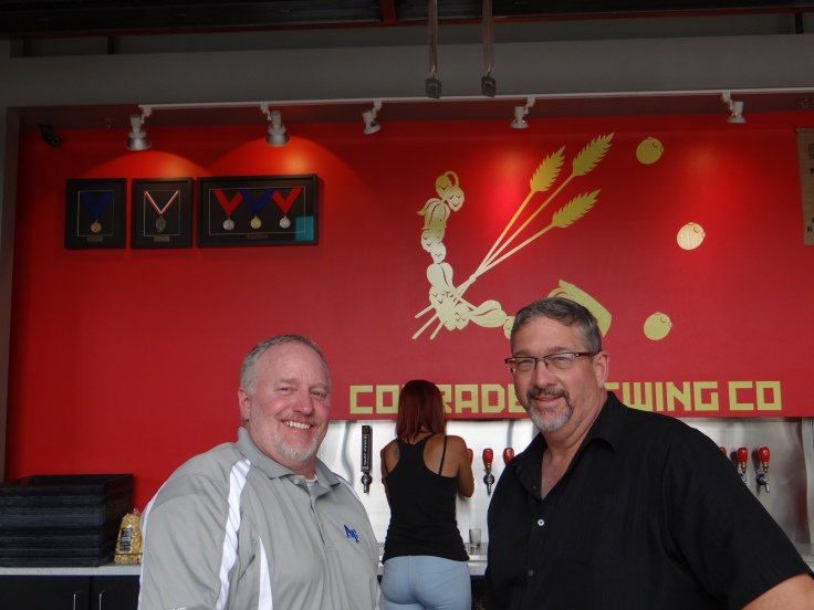 Nick (left) and Ralph (right) pose for a photo at Comrade Brewing. Although only open 15 months at the time of our visit notice the hardware in the upper left.